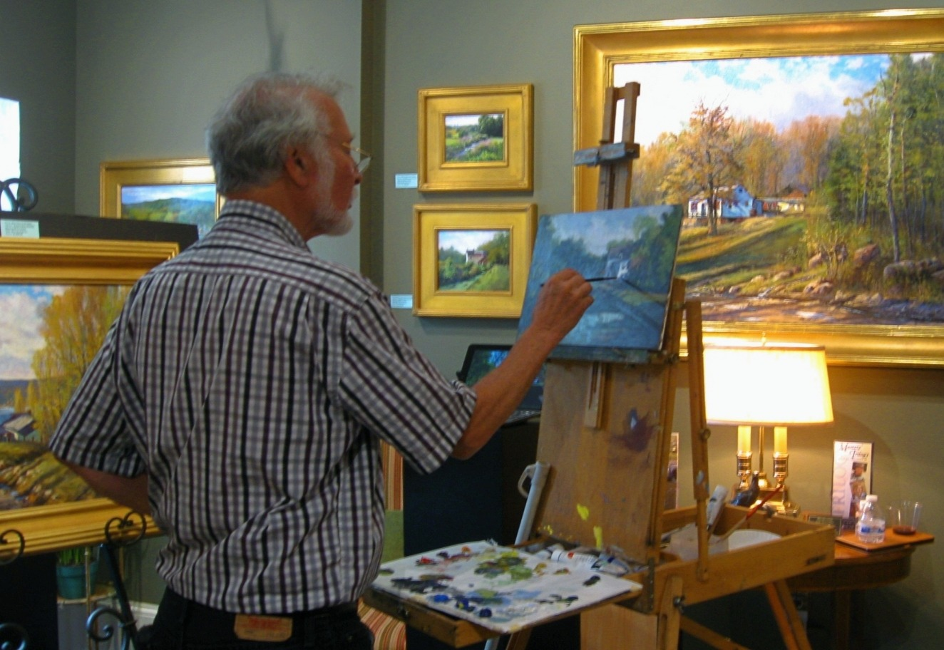 Artists Joseph Orr painting at his easel