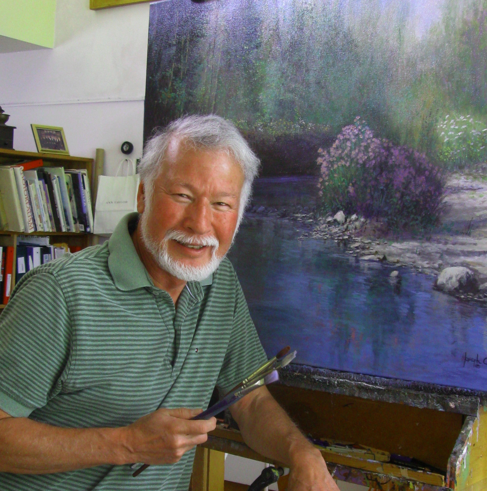 Artist Joseph Orr in front of one of his paintings
