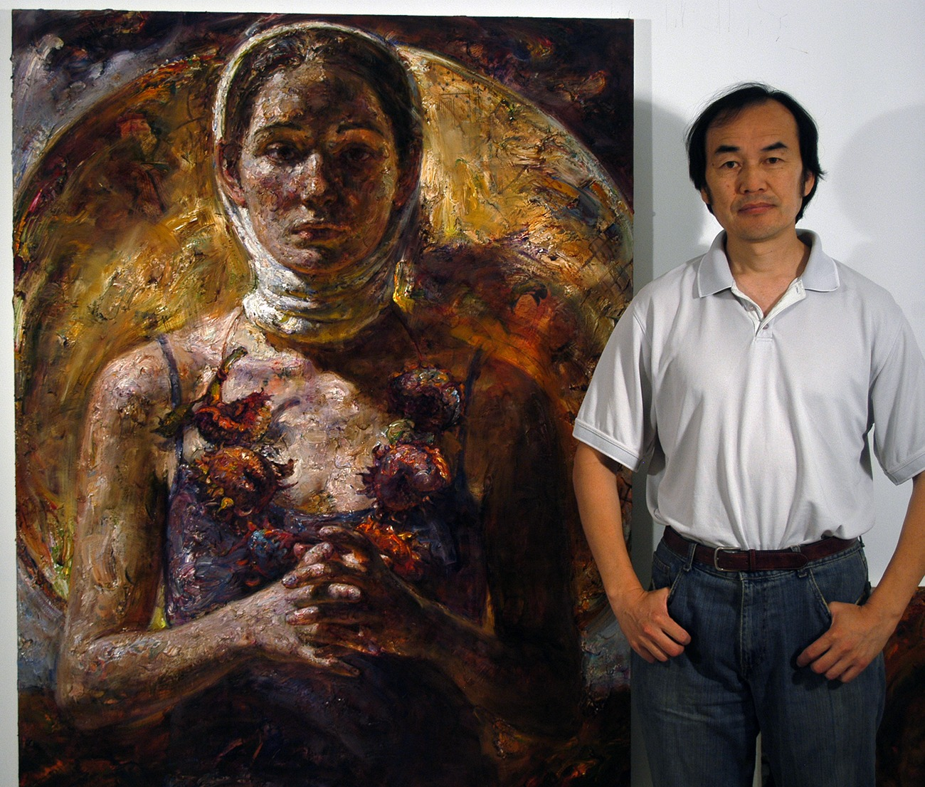 Artist Victor Wang Standing in Front of One of His Paintings